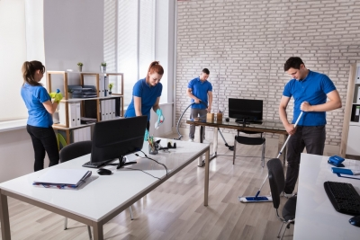group of janitors cleaning the modern office