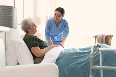 Care worker with elderly women in geriatric hospice